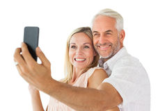 Happy couple posing for a selfie Royalty Free Stock Image