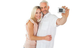 Happy couple posing for a selfie Royalty Free Stock Photos