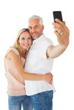 Happy couple posing for a selfie Stock Photos