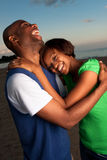 Happy couple posing at sunset Stock Images