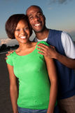 Happy couple posing at sunset Royalty Free Stock Images