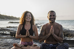 Happy couple practicing yoga Royalty Free Stock Image
