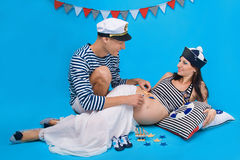 A happy couple during pregnancy in a marine style Stock Photography