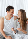 Happy couple with a pregnancy test Stock Image