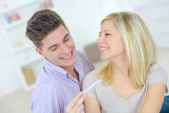 Happy couple with pregnancy test Stock Photos