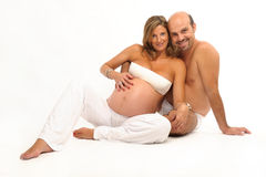 Happy couple with pregnant woman royalty free stock photo