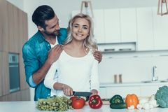 Happy couple preparing breakfast together in kitchen. Family of vegans. Vegetarianism concept Royalty Free Stock Images