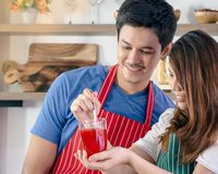 Happy couple preparing healthy drink stock photo