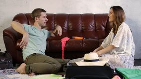 Happy couple preparing for vacation at home stock video