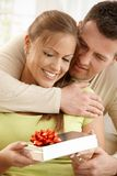 Happy couple with present Royalty Free Stock Image