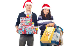 Happy couple with purchased gifts. Happy young couple holding purchased gifts isolated on white background Stock Photos