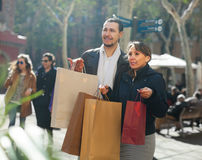 Happy couple with purchases Royalty Free Stock Photo