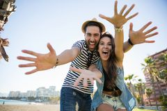 Happy couple raising hands having fun Royalty Free Stock Photos