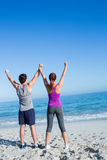 Happy couple raising their hands Stock Photography