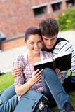 Happy couple reading a book together Stock Photo