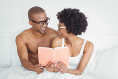 happy couple reading a book together Royalty Free Stock Photo