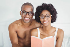 happy couple reading a book together Stock Photos