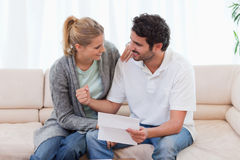 Happy couple reading a letter Royalty Free Stock Photo