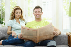 Happy couple reading news Stock Photos