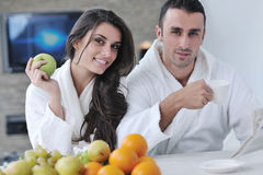 Happy couple reading the newspaper in the kitchen Royalty Free Stock Photography