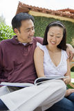 Happy Couple Reading Novel Royalty Free Stock Photo