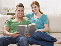 Happy Couple Reading Together Stock Images
