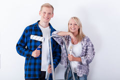 Happy couple ready for home renovation Stock Photo