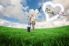 Happy couple ready to go on holiday Royalty Free Stock Image