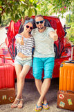 Happy couple ready to trip Stock Photography