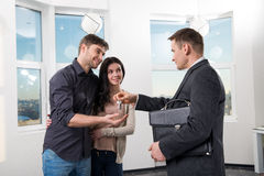 Happy couple with real estate agent Stock Photography