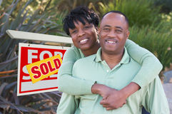 Happy Couple and Real Estate Sign stock photos