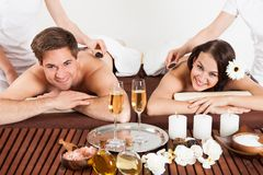 Happy Couple Receiving Shoulder Massage At Beauty Spa Royalty Free Stock Image