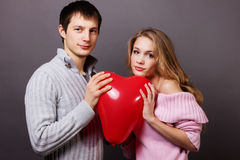 Happy couple with red balloon.Valentines day Stock Image