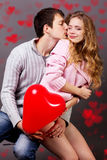 Happy couple with red balloon.Valentines day Royalty Free Stock Image