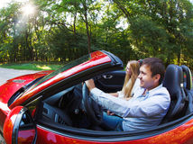 Happy couple in red cabriolet Stock Photography