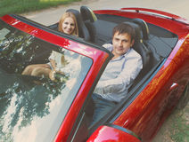 Happy couple in red cabriolet Royalty Free Stock Photography