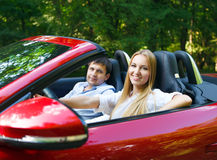 Happy couple in red cabriolet Royalty Free Stock Image