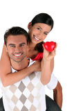 Happy couple with red heart Royalty Free Stock Photos