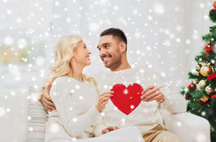 Happy couple with red heart at home for christmas Stock Images