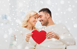 Happy couple with red heart hugging at home Stock Images