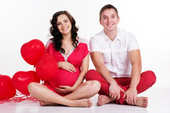 Happy couple with red heart shape balloons Stock Photos