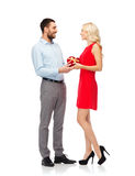 Happy couple with red heart shaped gift box Royalty Free Stock Photo