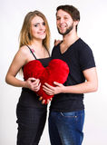 Happy couple with red heart Stock Photo