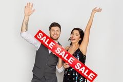 Happy couple with red sale sign. Shopping, people and fashion concept - happy couple with red sale sign Stock Photo