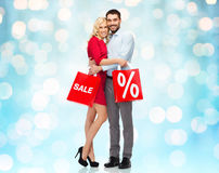 Happy couple with red shopping bags Royalty Free Stock Photo