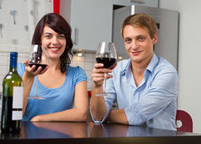Happy couple with red wine at home Royalty Free Stock Images