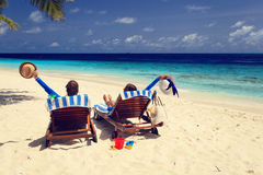 Happy couple relax on beach Stock Photography
