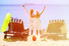 Happy couple relax on a tropical beach. Happy couple relax on a tropical sand beach Royalty Free Stock Images