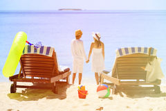 Happy couple relax on a tropical beach. Happy couple relax on a tropical sand beach Royalty Free Stock Image
