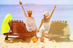 Happy couple relax on a tropical beach. Happy couple relax on a tropical sand beach Royalty Free Stock Photos